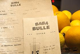Menu des Zen Zoo (bubble Tea) de Baba Bulle, sur craft, avec agrumes en arrière plan